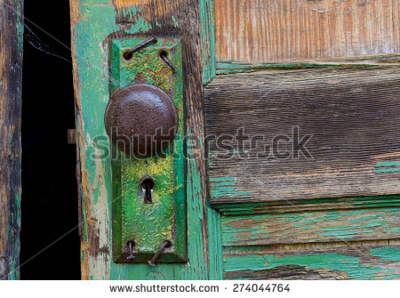 stock-photo-old-door-and-rusty-keyhole-with-bent-nails-from-a-world-war-ii-army-barrack-274044764